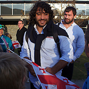 Georgian player Givi Berishvili is greeted by youngsers from the Wakatipu and Arrowtown Rugby Clubs at the Georgia team arrival at Queenstown airport in preparation for the Rugby World Cup 2011. Queenstown, New Zealand, 4th September 2011. Photo Tim Clayton
