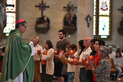 July 30, 2017 - San Antonio Archbishop GUSTAVO GARCIA-SILLER speaks during a mass in memorium for the 10 immigrants that were found dead in a semi-trailer last week in San Antonio. Each candle held by the parishoners synbolized one of those that were killed. (Credit Image: © Robin Jerstad via ZUMA Wire)