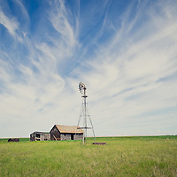 wind mill and homestead on montana prairie