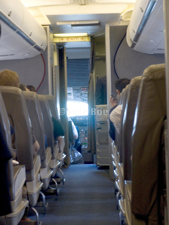 view towards the cockpit in a commercial airplane