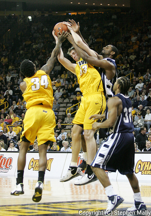 24 JANUARY 2007: Iowa center Seth Gorney (53) grabs a rebound while being fouled by Penn State forward Brandon Hassell (23) as Iowa forward Tyler Smith (34) helps and Penn State guard David Jackson (32) looks on in Iowa's 79-63 win over Penn State at Carver-Hawkeye Arena in Iowa City, Iowa on January 24, 2007.