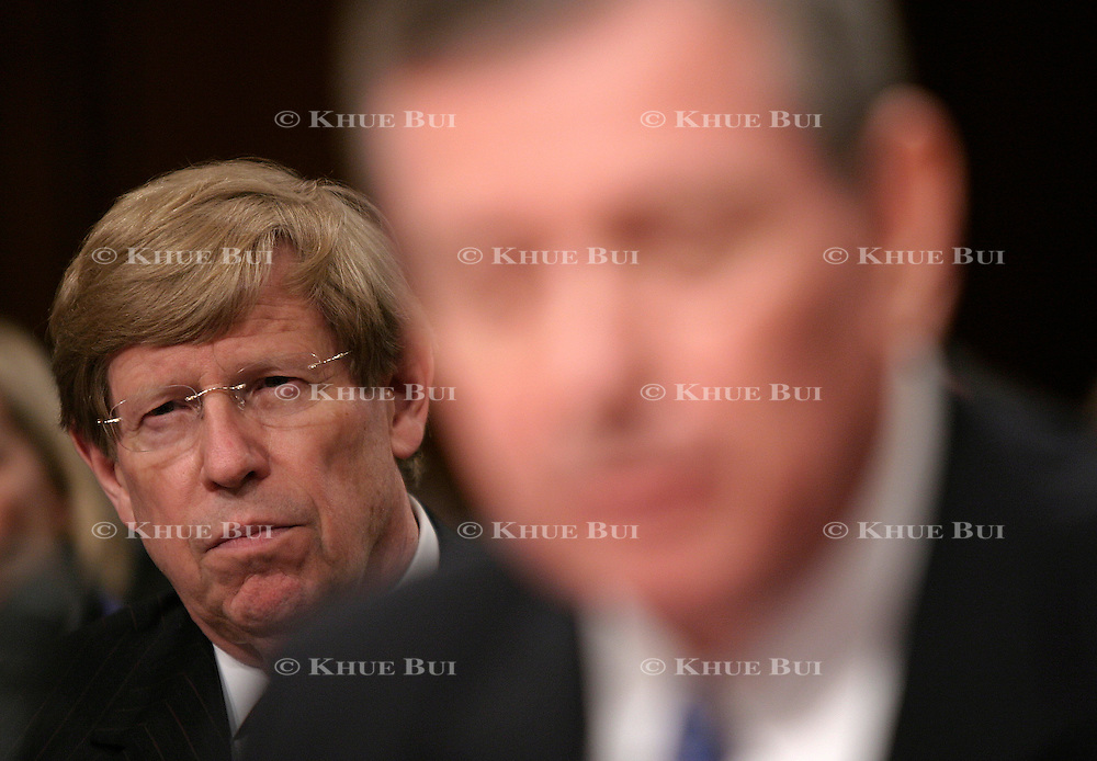 Solicitor General Ted Olsen listens as Attorney General John Ashcroft testifies before the 9/11 commission Tuesday, April 13, 2004, on Capitol Hill.  Olsen lost his wife on the plane that crashed into the Pentagon...Photo by Khue Bui