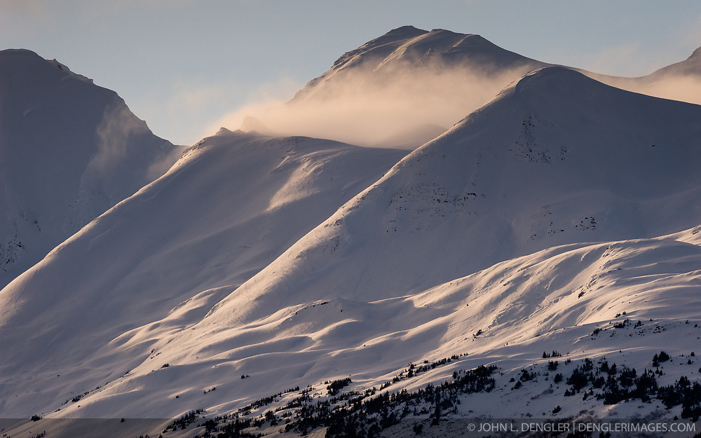 Afternoon sunlight shines on the slopes of Mount Jonathan Ward outside Haines, Alaska near the Alaska Chilkat Bald Eagle Preserve. Mountains in the Haines area are a popular destination for heli-skiing.