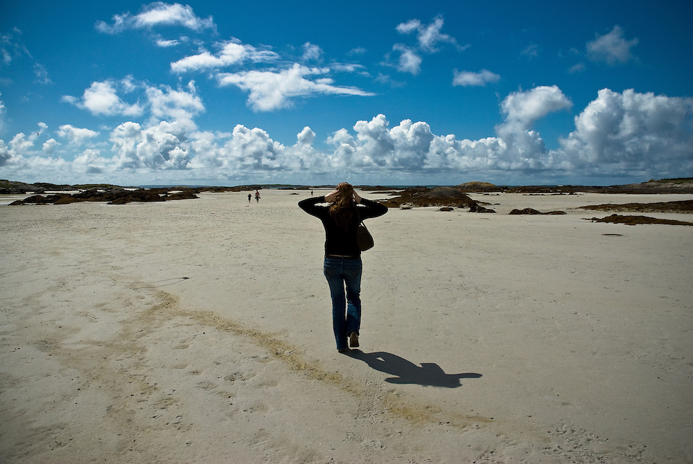 A woman on an almost empty beach in Connemara, Co. Galway, Ireland. August 2006.
