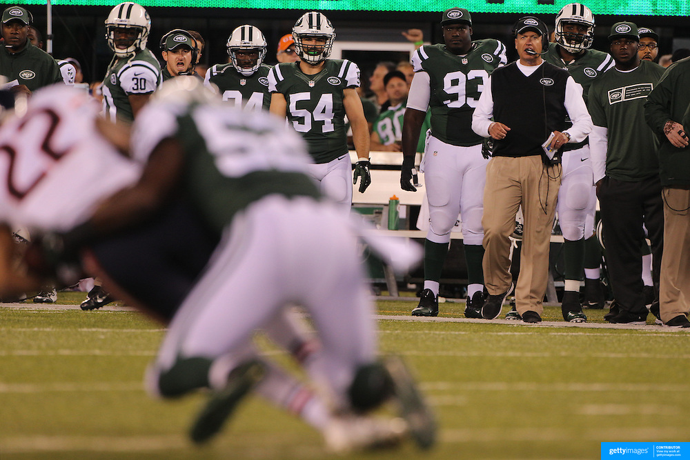Rex Ryan, Head Coach of the New York Jets, watching action from the sideline during the New York Jets Vs Chicago Bears, NFL regular season game at MetLife Stadium, East Rutherford, NJ, USA. 22nd September 2014. Photo Tim Clayton for the New York Times