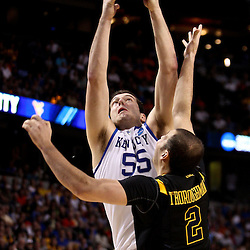 Mar 19, 2011; Tampa, FL, USA; Kentucky Wildcats forward Josh Harrellson (55) rebounds over West Virginia Mountaineers forward Cam Thoroughman (2) during the second half of the third round of the 2011 NCAA men's basketball tournament at the St. Pete Times Forum. Kentucky defeated West Virginia 71-64.  Mandatory Credit: Derick E. Hingle