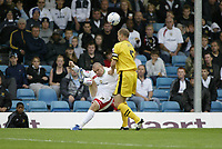 Photo: Marc Atkins.<br />Milton Keynes Dons v Notts County. Coca Cola League 2. 02/09/2006. Jon Paul McGovern crosses the ball under pressure from Alan White of Notts County (R).