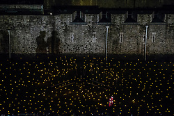 © Licensed to London News Pictures. 06/11/2018. LONDON, UK. 'Beyond the Deepening Shadow: The Tower Remembers'  <br /> An installation at The Tower of London. Which consists of thousands of individual flames illuminate the moat of The Tower of London to mark 100 year since the first World War ended, The installation entitled 'Beyond the Deepening Shadow: The Tower Remembers', is a public act of remembrance for the lives of the fallen, honouring their sacrifice will run for eight nights, leading up to and including the Centenary Armistice Day 2018. <br />   Photo credit: Andrew Baker/LNP