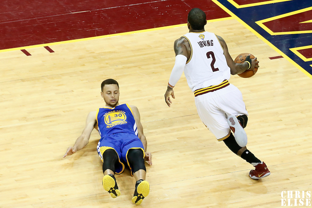 10 June 2016: Cleveland Cavaliers guard Kyrie Irving (2) drives past Golden State Warriors guard Stephen Curry (30) during the Golden State Warriors 108-97 victory over the Cleveland Cavaliers, during Game Four of the 2016 NBA Finals at the Quicken Loans Arena, Cleveland, Ohio, USA.