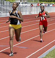 Meadowdale (left) and Trotwood-Madison (right) compete during the Girls 800 Meter Run in the Buff Taylor Memorial Track & Field Invitational at the Good Samaritan Sports Plex at Trotwood Madison High School, Saturday, May 10, 2008.