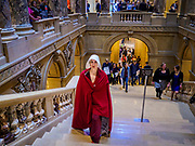 "04 MAY 2017 - ST. PAUL, MN: A woman dressed as a handmaid (from the novel and Hulu series ""A Handmaid's Tale"") climbs the stairs to the Minnesota State Senate. About 50 people came to a protest to urge Minnesota State Senators to vote against two bills supported by the Republican party that would restrict access to women's health care in Minnesota. The protest was organized by  NARAL Pro-Choice Minnesota, NCJW Minnesota, and Planned Parenthood Minnesota. The Senate passed the bills but Minnesota's Democratic governor is expected to veto the legislation when it reaches his desk.     PHOTO BY JACK KURTZ"