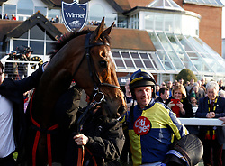 Noel Fehily and Get In The Queue return after winning, on his last ride before retiring, The Goffs UK Spring Sale Bumper Race run during Be Wiser Jumps Season Finale Saturday at Newbury Racecourse, Newbury.