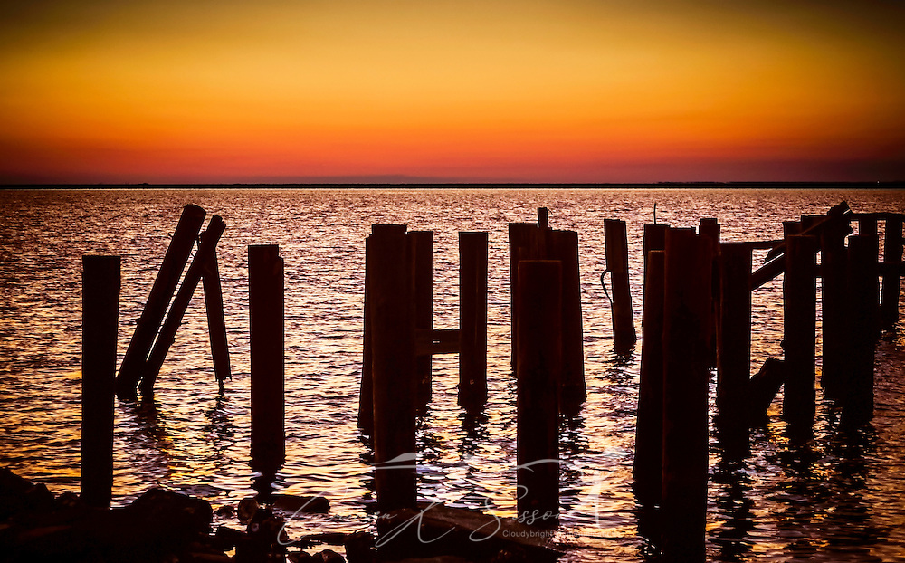 The sun sets over Heron Bay at the Heron Bay Cutoff, March 28, 2015, in Dauphin Island, Alabama. (Photo by Carmen K. Sisson/Cloudybright)