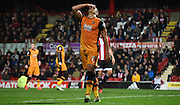 Jake Livermore can't quite believe the sitter he's missed during the Sky Bet Championship match between Brentford and Hull City at Griffin Park, London, England on 3 November 2015. Photo by Michael Hulf.