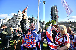 © Licensed to London News Pictures. 19/10/2019. London, UK. Pro Brexit demonstrators gather outside The Houses of Parliament in Westminster, London on the day that Parliament will vote on a new agreement between UK government and the EU over Brexit. Parliament is sitting on a Saturday for the first time since 1982. Photo credit: Ben Cawthra/LNP