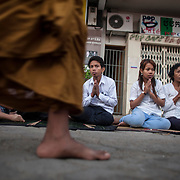 Buddhist monks walk past mourners as they gather for a funeral procession of former Cambodian King Norodom Sihanouk  Friday, Feb. 1, 2013 in Phnom Penh. The royal cremation ceremony for former Cambodian King Norodom Sihanouk is scheduled on 04 February 2013, after he died on 15 October 2012 in Beijing, China, at the age of 89..
