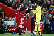 Liverpool defender Andrew Robertson (26) and Liverpool goalkeeper Alisson Becker (13) during the Premier League match between Liverpool and Everton at Anfield, Liverpool, England on 2 December 2018.
