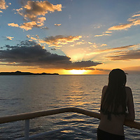 oceania, Fiji, Mamanuca Islands. Sunset view from deck of Captain Cook Cruises Reef Endeavor.