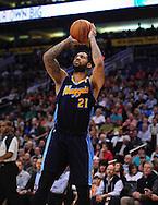 Mar. 10, 2011; Phoenix, AZ, USA; Denver Nuggets forward Wilson Chandler (21) puts up a basket against the Phoenix Suns at the US Airways Center. Mandatory Credit: Jennifer Stewart-US PRESSWIRE