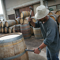 SETTLER'S BOUTIQUE WINE 2009...A Palestinian worker during renovation of barrels of Tanya boutique winery, during renovation of wine barrels in the West Bank Jewish settlement of Ofra, October 2009.