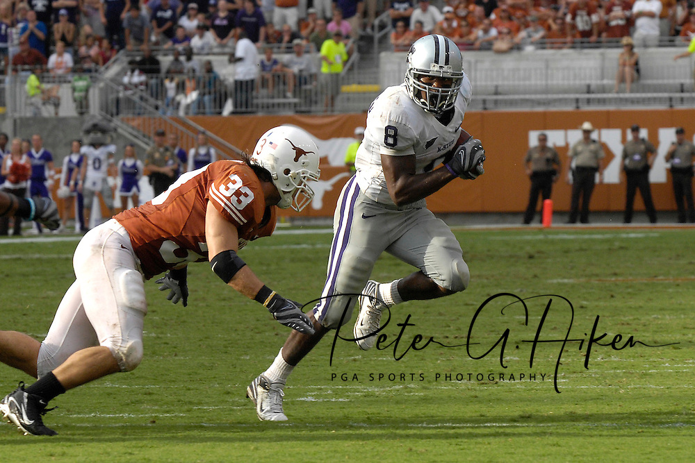 September 29, 2007 - Austin, TX..Running back James Johnson #8 of the Kansas State Wildcats rushes to the outside against pressure from linebacker Scott Derry #33 of the Texas Longhorns, during a NCAA football game at Darrell Royal-Texas Memorial Stadium on September 29, 2007...FBC:  The Wildcats defeated the Longhorn 41-21.  .Photo by Peter G. Aiken/Cal Sport Media