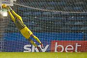 Wycombe Wanderers goalkeeper Stephen Henderson (28) makes a save in front of Sky Bet advertising during the EFL Sky Bet League 1 match between Gillingham and Wycombe Wanderers at the MEMS Priestfield Stadium, Gillingham, England on 15 December 2018.