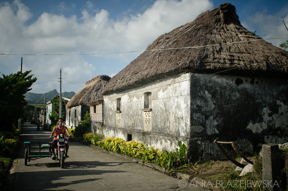 Philippines, Batanes. Main street in Savidug, one of the villages situated on Sabtang Island, where beautiful traditional Ivatan houses are built.