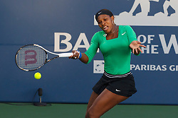 July 30, 2011; Stanford, CA, USA;  Serena Williams (USA) returns the ball against Sabine Lisicki (GER), not pictured, during the semifinals of the Bank of the West Classic women's tennis tournament at the Taube Family Tennis Stadium.