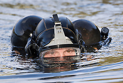 © Licensed to London News Pictures. 19/10/2016. Oxshott, UK. A member of a specialist dive team searches Littleheath Pond near Oxshott, Surrey in connection with the murder of 50-year-old Robyn Mercer. The body of Mother-of-two, Robyn Mercer was discovered outside a residential address in West Molesey in March.  Photo credit: Peter Macdiarmid/LNP