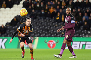 Hull City midfielder Jackson Irvine (16) heads the ball past Swansea City midfielder Leroy Fer (8) during the EFL Sky Bet Championship match between Hull City and Swansea City at the KCOM Stadium, Kingston upon Hull, England on 22 December 2018.