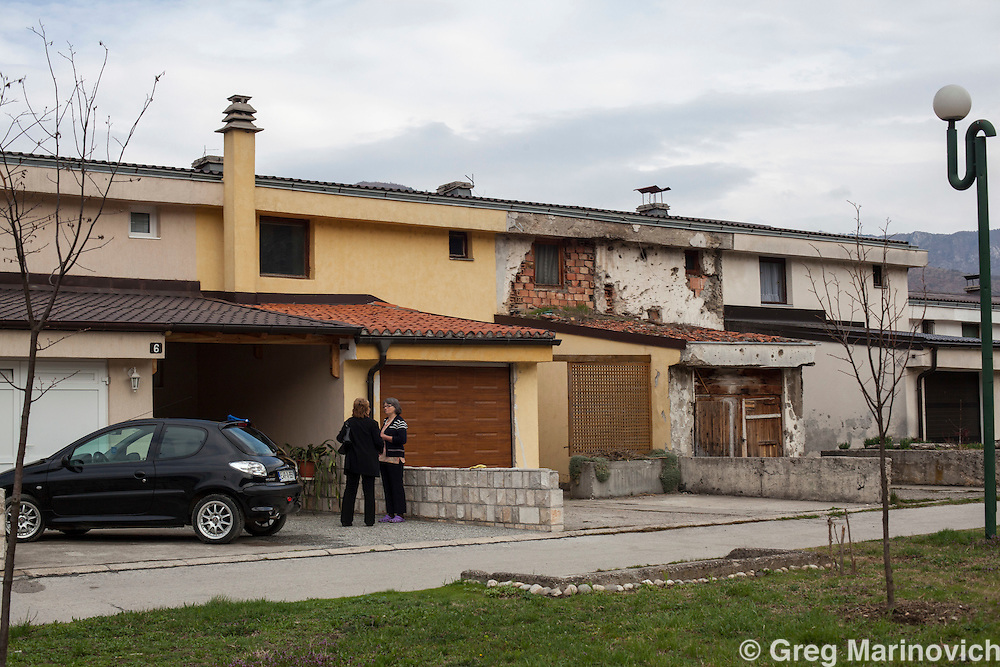 Gorazde, Bosnia and Herzegovina, April 6, 2012. A war-scarred home that belonged to a Serbian man killed in the war now houses a homeless Bosnian  displacee woman while the homes on either side have been gentrified and refurbished by their Bosnian owners.  Greg Marinovich