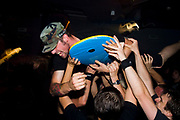 Young male crowd surfing in the audience at Municipal Waste gig, at Louvre. Prague, Czech Republic. 21 & 22/05/07