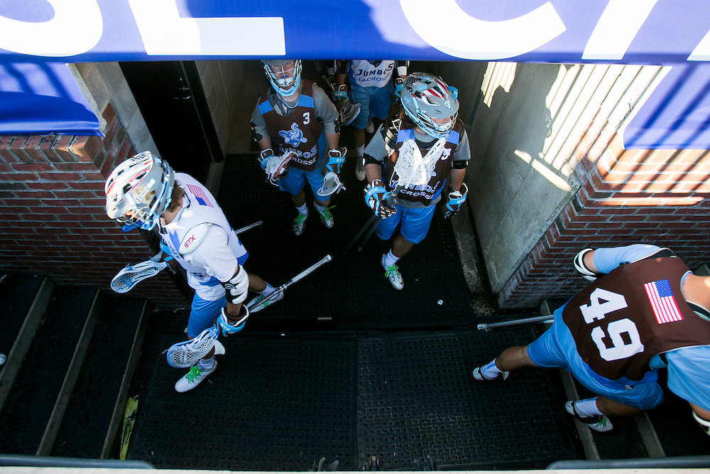 05/24/2014 - Baltimore, Md. - The Tufts men's lacrosse team make their way out of the Baltimore Ravens locker room tunnel and head toward the field for practice for the NCAA Division III National Championship at M&T Stadium on May 24, 2014. (Kelvin Ma/Tufts University)