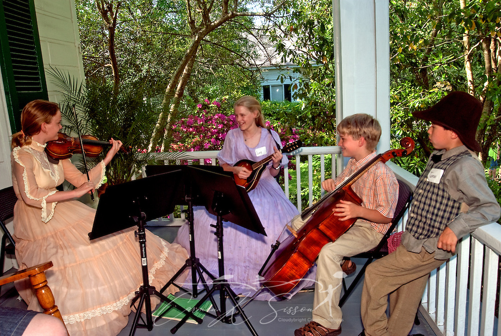 The Sumic Trio performs on the porch of Twelve Gables during the annual Spring Pilgrimage in Columbus, Miss. April 16, 2010. From left are siblings Laura Sandifer, Lucy Sandifer, Scott Sandifer, and James Sandifer. (Photo by Carmen K. Sisson/Cloudybright)