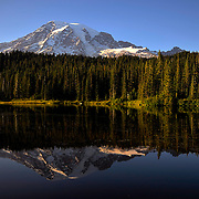Mount Rainier looms above Reflection Lake at sunset near Paradise, Washington.