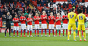 Charlton Athletic players hold a minute of applause to remember those lost in 2015 before the Sky Bet Championship match between Charlton Athletic and Nottingham Forest at The Valley, London, England on 2 January 2016. Photo by Andy Walter.