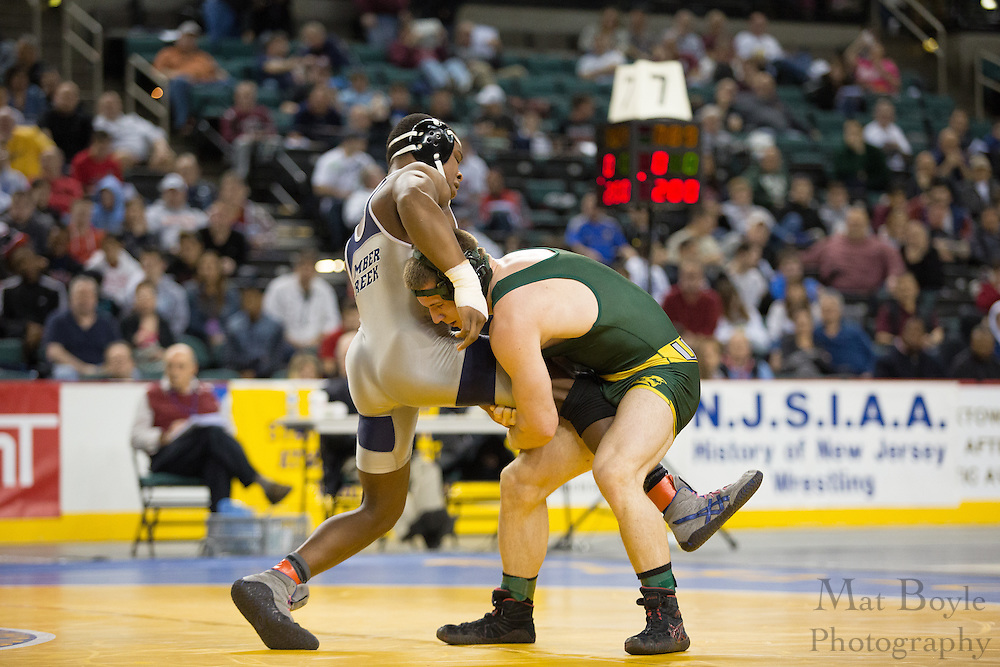 Connor Donahue of Clearview (Green) defeats Bryce Shade of Timber Creek in the 160 lb 3rd place match in the NJ State Wrestling Tournament at Boardwalk Hall in Atlantic CIty, NJ on Sunday March 10, 2013. (photo / Mat Boyle)