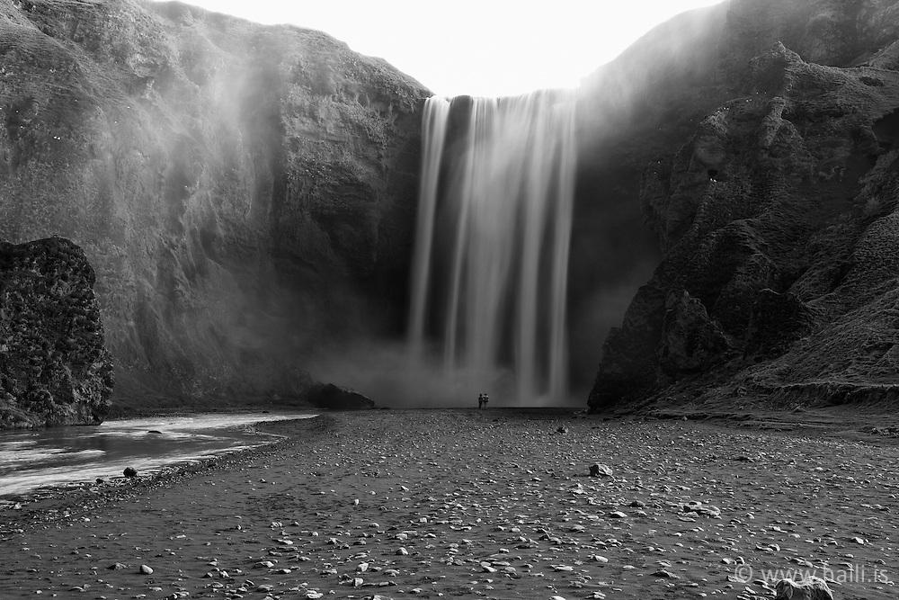 The waterfall Skogafoss all grey after volcanic ash from the eruption in Eyjafjallajokull, Iceland - Skógafoss öskugrár vegna eldgossins í Eyjafjallajökli