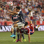 Javi Martinez, FC Bayern Munich, attempts an overhead kick during the FC Bayern Munich vs Chivas Guadalajara, Audi Football Summit match at Red Bull Arena, New Jersey, USA. 31st July 2014. Photo Tim Clayton