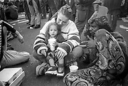 Child with cup, Reclaim the Streets, Trafalgar Square, London, May 1997