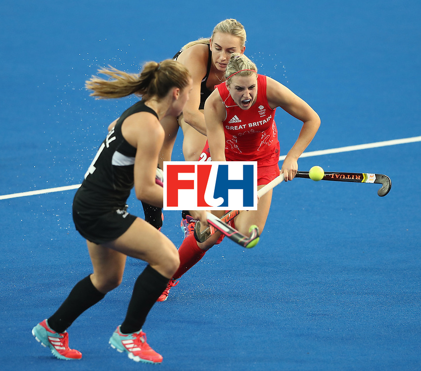 RIO DE JANEIRO, BRAZIL - AUGUST 17:  Lily Owsley of Great Britain breaks with the ball during the Women's hockey semi final match betwen New Zealand and Great Britain on Day12 of the Rio 2016 Olympic Games at the Olympic Hockey Centre on August 17, 2016 in Rio de Janeiro, Brazil.  (Photo by David Rogers/Getty Images)