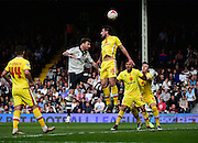 Fulham Defender Fernando Amorebieta (45) heads from MK Dons Defender Joe Walsh (16) during the Sky Bet Championship match between Fulham and Milton Keynes Dons at Craven Cottage, London, England on 2 April 2016. Photo by Jon Bromley.