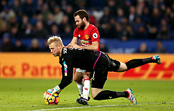 Kasper Schmeichel of Leicester City jumps on the ball before Juan Mata of Manchester United - Mandatory by-line: Robbie Stephenson/JMP - 05/02/2017 - FOOTBALL - King Power Stadium - Leicester, England - Leicester City v Manchester United - Premier League