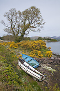 Two boats tied at the shore in Kenmare Bay in Kenmare, County Kerry, Ireland.