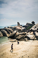 "The shoreline and the famous ""grandfather"" rock on the eastern coast of Koh Samui in southern Thailand."