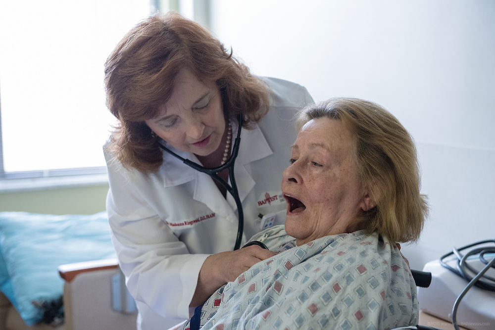 Hospitalist Madonna Ringswald, DO, FAAIM, examines patient Dora Gribbons Wednesday, May 27, 2015 at Baptist Health in LaGrange, Ky. (Photo by Brian Bohannon/Videobred for Baptist Health)