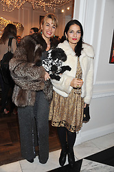 Left to right, ASSIA WEBSTER and YASMIN MILLS at a party to celebrate thelaunch of Alice Temperley's flagship store Temperley, Bruton Street, London on 6th December 2012.