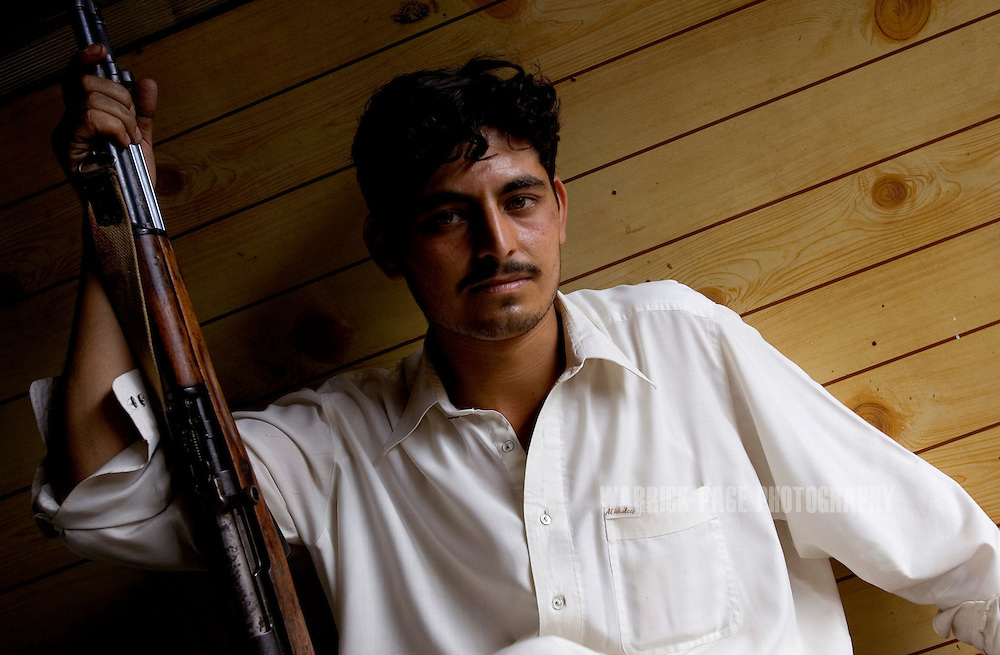 DARA ADAM KHEL, PAKISTAN - MAY 29: A gunsmith holds a rifle in his store in the tribal village of Darra Adam Khel, near the Afghan border, May 29, 2006. Darra came under the control of the Taliban in late 2006, who have since imposed strict curfews and laws on the local tribal population. In the arms trade for more than a century, the Pashtuns of Darra were trained to make ordinance by the British to regularly supply their troops in neighboring Afghanistan. Since then craftsmen have passed down their techniques from father-to-son. Their weapons have been used in conflicts from Bosnia to Kashmir due to their cheap cost, and reliable craftsmanship. (Photo by Warrick Page)