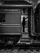 Train master on a pullman car.
