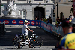 Pedestrian with bicycle at prologue (17,8km) of Tour de Slovenie 2012, on June 17 2012, in Ljubljana, Slovenia. (Photo by Matic Klansek Velej / Sportida.com)